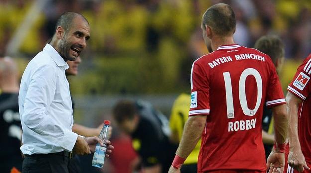 غوارديولا يوجه روبن خلال المباراة أمام دورتموند