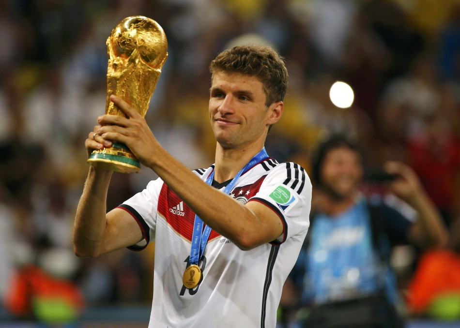 449188-germanys-thomas-mueller-holds-up-the-trophy-after-winning-the-2014-wor