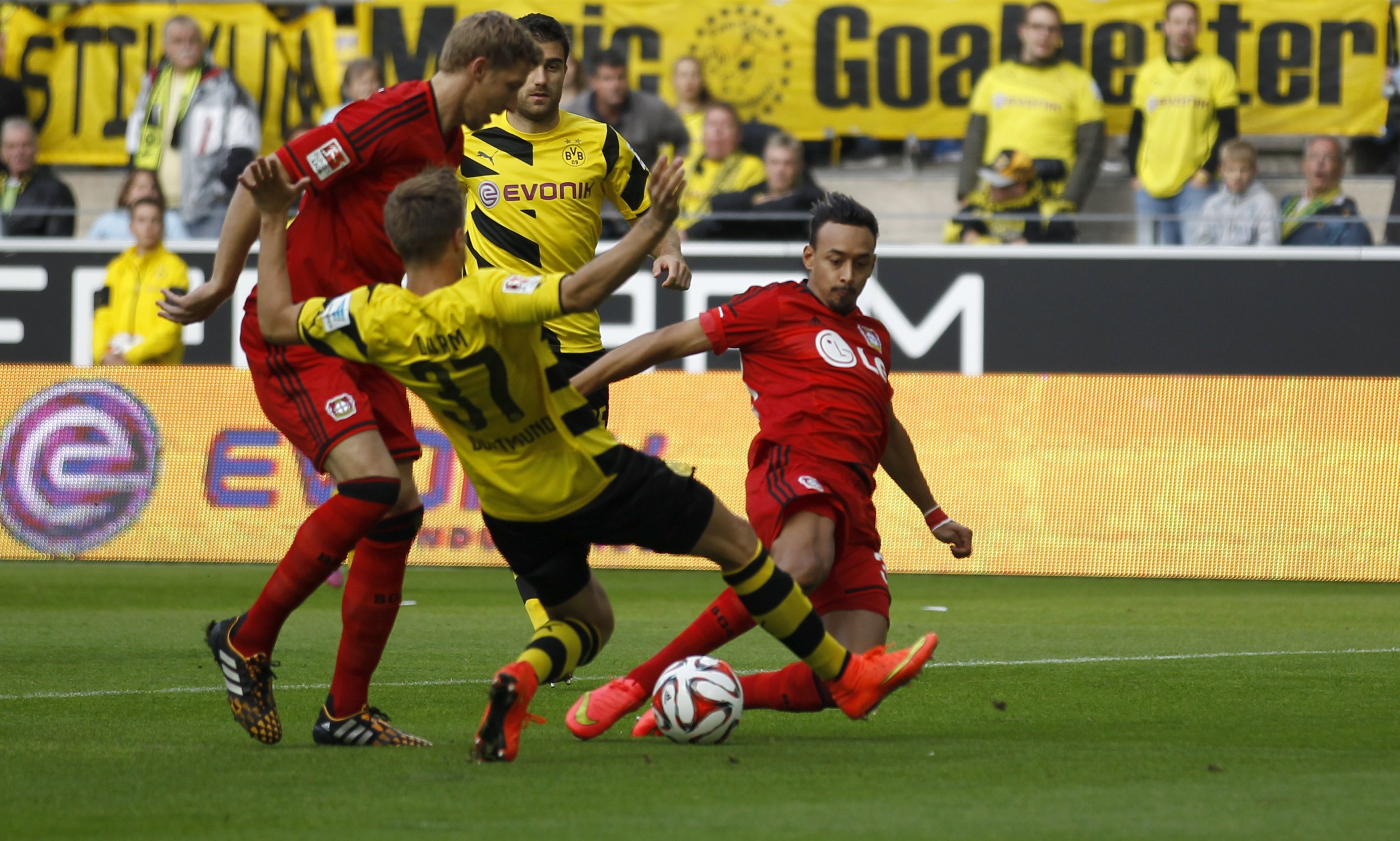 Bayer Leverkusen's Bellerabi scores a goal against Borussia Dortmund during the German first division Bundesliga soccer match in Dortmund